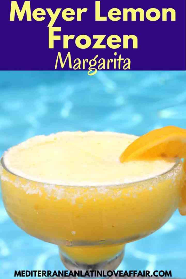 An image created specifically for Pinterest. It has the picture of the frozen lemon margarita as well as a title bar on top of the picture as well as the website link in the bottom.