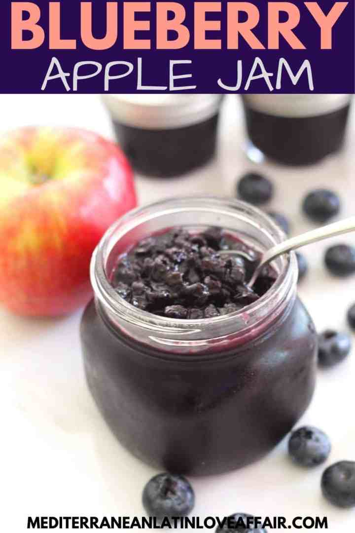 An image prepared for Pinterest that shows a picture of the Blueberry Apple Jam in a jar. On top is a title bar and on the bottom the website link.