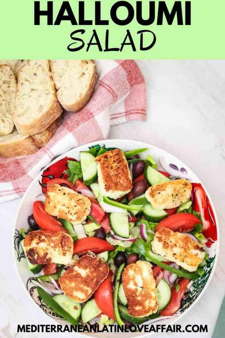 A vegetable salad with fried halloumi cheese shown next to a basket of bread. #mediterraneanlatinloveaffair, #salad, #halloumi