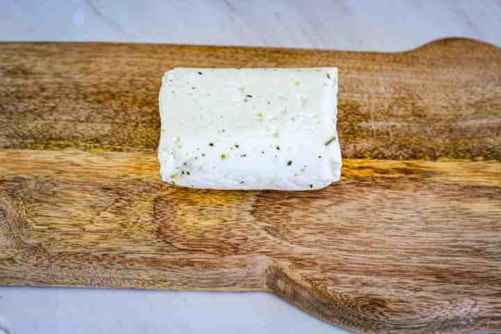 Halloumi cheese on a cutting board.