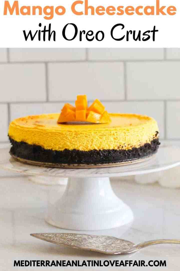 An image prepared for Pinterest, it shows the mango oreo cheesecake in the center of the image served on a white cake stand. On top of the picture there's a title bar and at the bottom a website link.