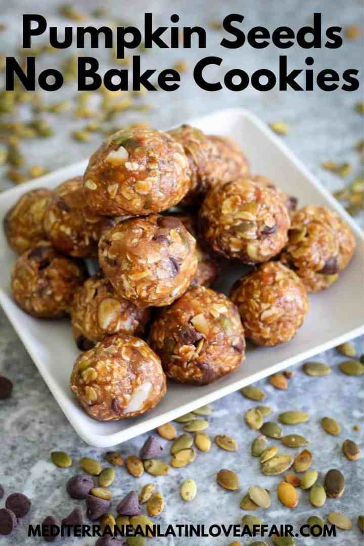 An image prepared for Pinterest. It shows the pumpkin seeds no bake cookies on a platter. On top of the image there's a title bar and on the bottom a website link.