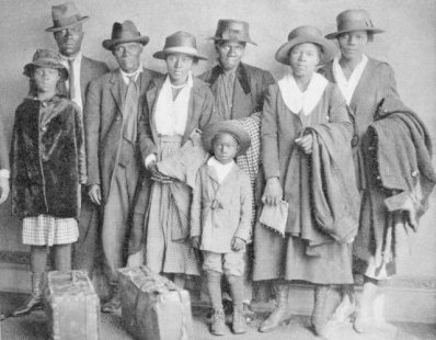 Photograph of African American men, women, and children who participated in the Great Migration to the north, with suitcases and luggage placed in front, Chicago, 1918. (Photo by Chicago History Museum/Getty Images)