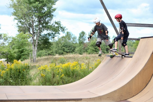 learning to skate board on the half pipe