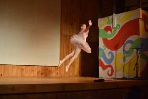 ballerina doing a grand jete across sstage