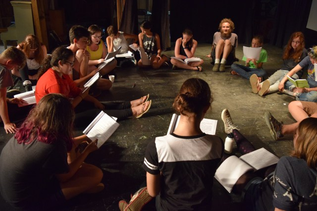 campers reading through a script
