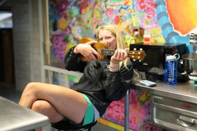 Staffer playing the ukelele