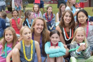 staffer sitting with her campers