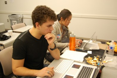"Bruno Faviero (left) and Iris Xu (right) work on the ""Visit-to-Visit"" web app. Photo credit: Ajay Major."