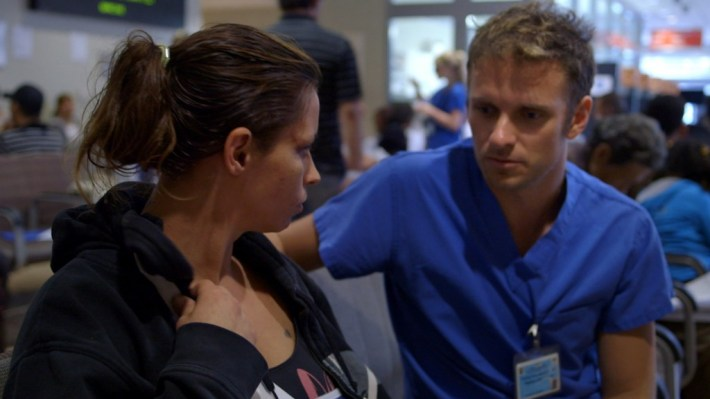 Director Ryan McGarry spends time with one of his patients during filming. Photo via codeblackmovie.com.