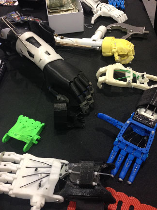 Prosthetic arms from e-Nabling the Future. Photo by Krina Patel.