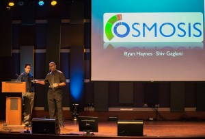 From left to right, Ryan Haynes and Shiv Gaglani present at DreamIt Health Demo Day. Photo courtesy of DreamIt Ventures.