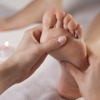 picture of foot receiving reflexology