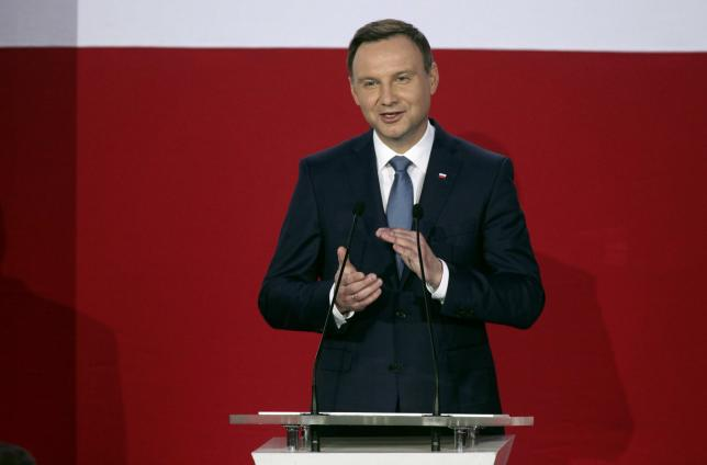 Andrzej Duda, presidential candidate of the Law and Justice Party (PiS) applauds as he addresses his supporters after the results of the exit polls on the second round of presidential elections in Warsaw, Poland, May 24, 2015. REUTERS/Slawomir Kaminski/Agencja Gazeta