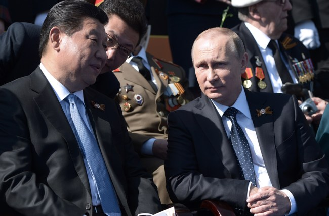 MOSCOW, RUSSIA. MAY 9, 2015. China's president Xi Jinping (L) and Russia's president Vladimir Putin attend a Victory Day military parade marking the 70th anniversary of the Victory over Nazi Germany in the Great Patriotic War of 1941-1945, in Moscow's Red Square. Alexei Nikolsky/Russian presidential press service/TASS