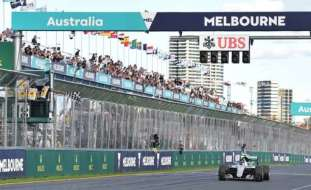 Rosberg takes the chequered flag to win the opening race Picture via Associated Press