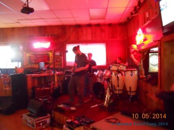 Ryan's the one with the dark shirt, playing guitar. Tom is wearing a cap, behind his congas.