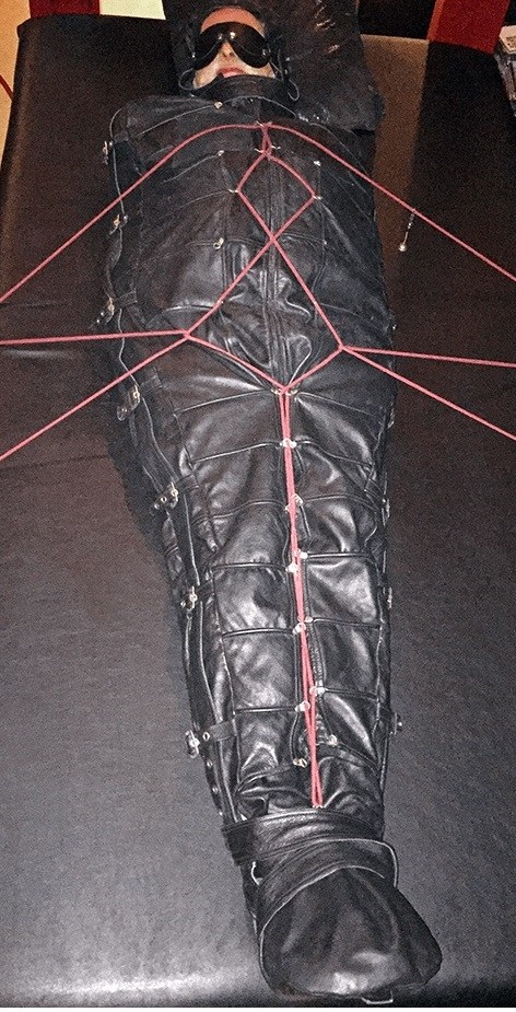 slave in a Leather Body Bag
