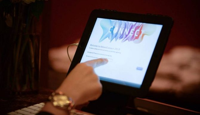 Attendee using touchscreen to register