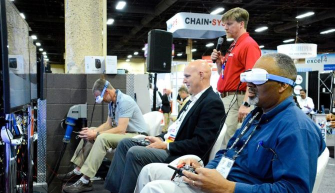Attendees viewing screen with VR headsets