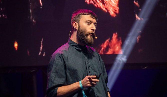 Keynote speaker on stage speaking