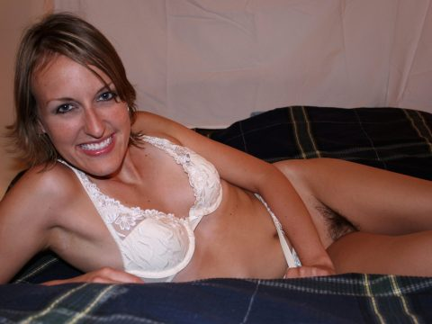 MeetLocalMILFs.Online - MILF Dating Site - Cute MILF With Beautiful Smile Posing On Bed In White Lingerie And Showing Her Hairy Pussy.