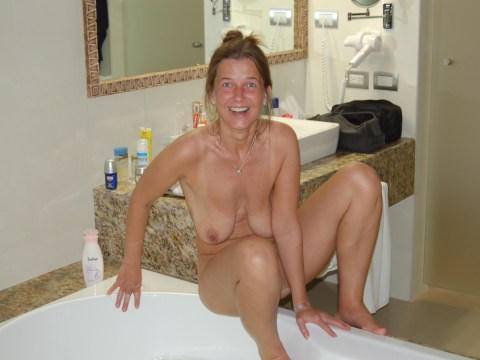 MeetLocalMILFs.Online - MILF Dating Site - Husband Taking Pic Of Naked MILF Wife In Bathroom Getting Ready For A Bath.