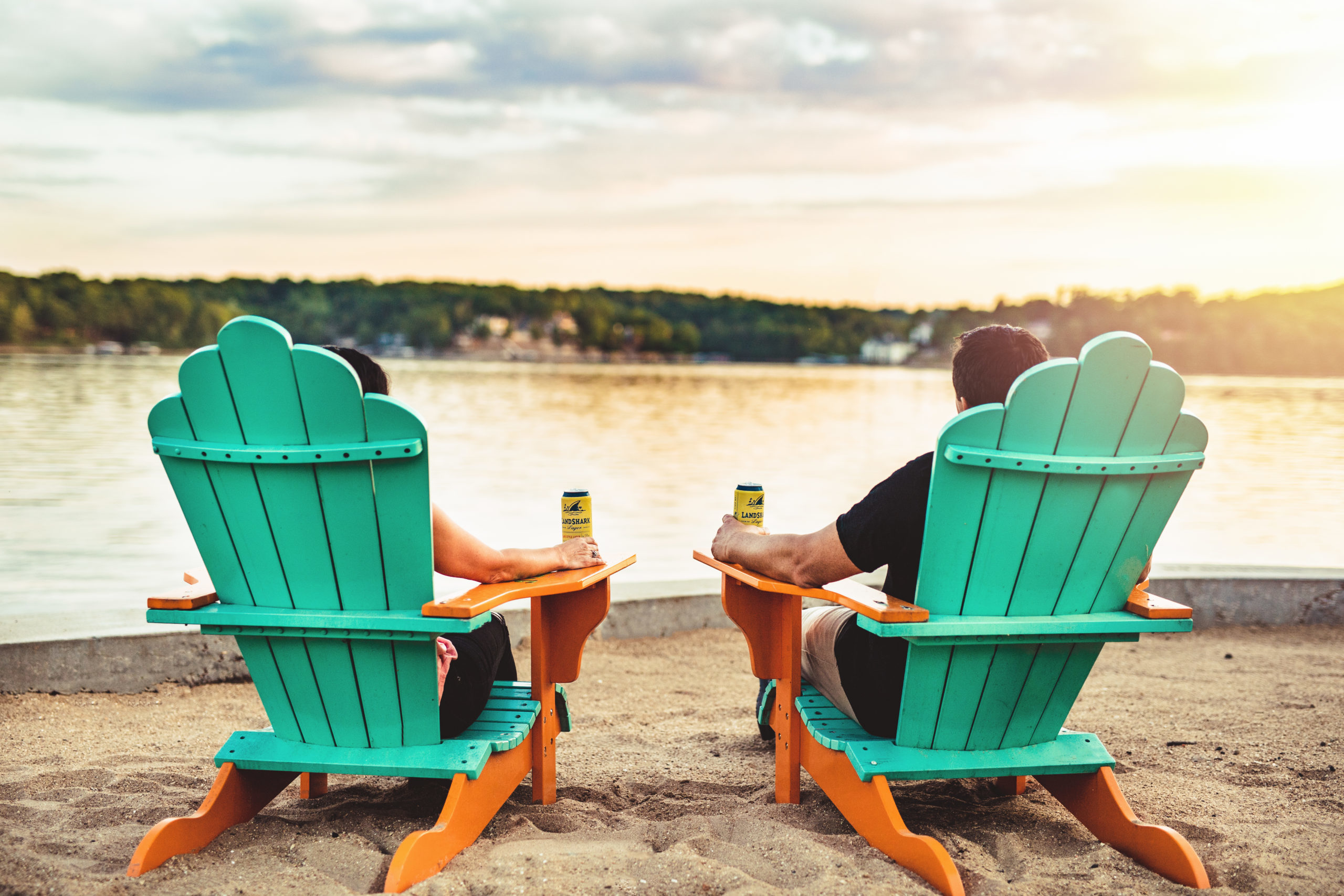 Couple in Chairs on Sand Beach scaled