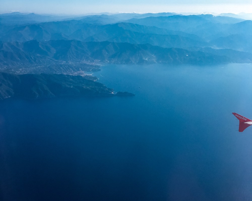A view of the cinque terre coastline and moutains from a plane