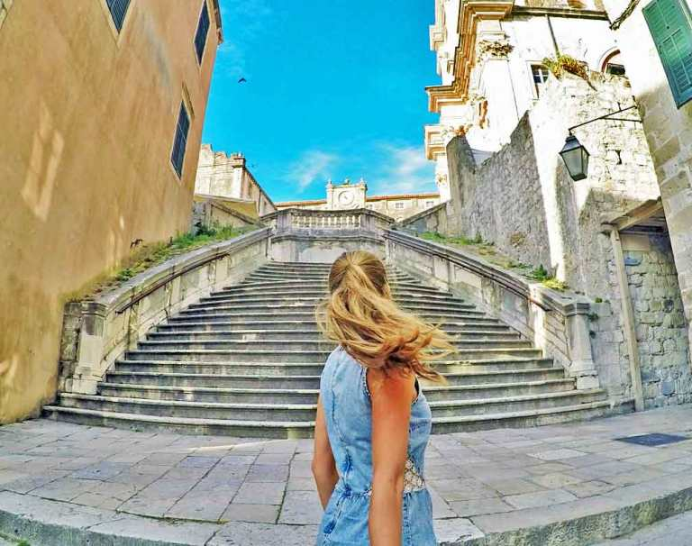 Inside the Old City of Dubrovnik looking up stone stairs