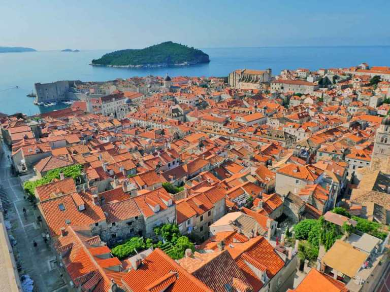 A view of the red rooftops of Dubrovnik Old Town with LokrumIsland in teh background view taken from the Dubrovnik Cable Car