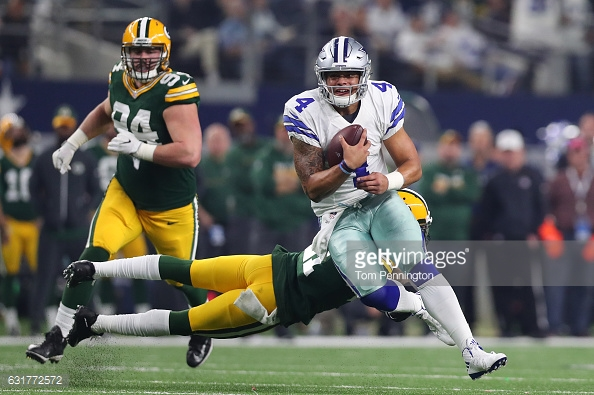 ARLINGTON, TX - JANUARY 15: Dak Prescott #4 of the Dallas Cowboys carries the ball during the third quarter against the Green Bay Packers in the NFC Divisional Playoff game at AT&T Stadium on January 15, 2017 in Arlington, Texas. (Photo by Tom Pennington/Getty Images)