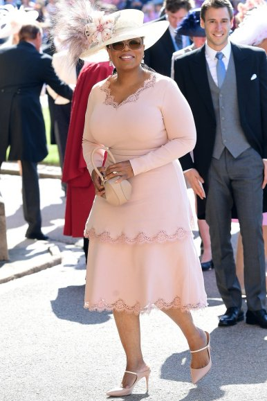 Oprah Winfrey wearing Stella McCartney and a Phillip Treacy hat.