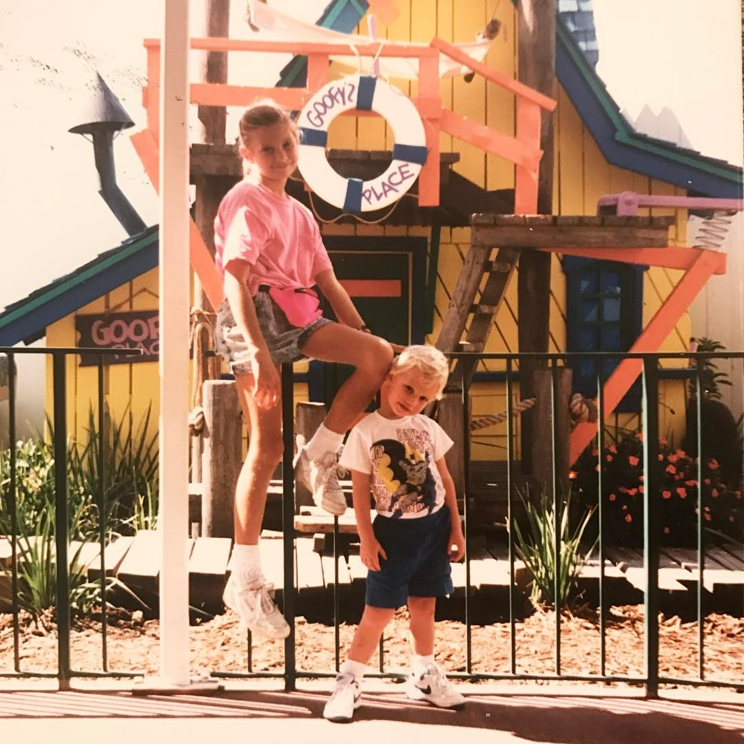 My brother & I rocking sensible footwear, a neon pink fanny pack, and an album-cover-worthy pose.