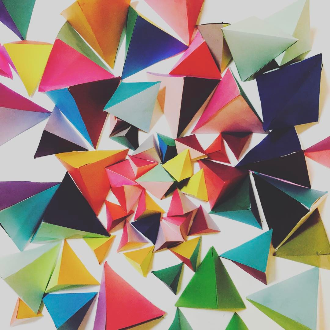 "Did I move several times with these 3D paper triangles that I made years ago with one of those moves being multiple states away. Yes. Yes I did. 🔺🔺🔺 These pieces were part of a wall installation in @makemagazine (2012) and a ""flat"" Christmas tree on @hgtvhandmade (2014). There's another unique DIY use for tiny ombré pink & purple triangles coming to a screen near you to brighten your winter up."