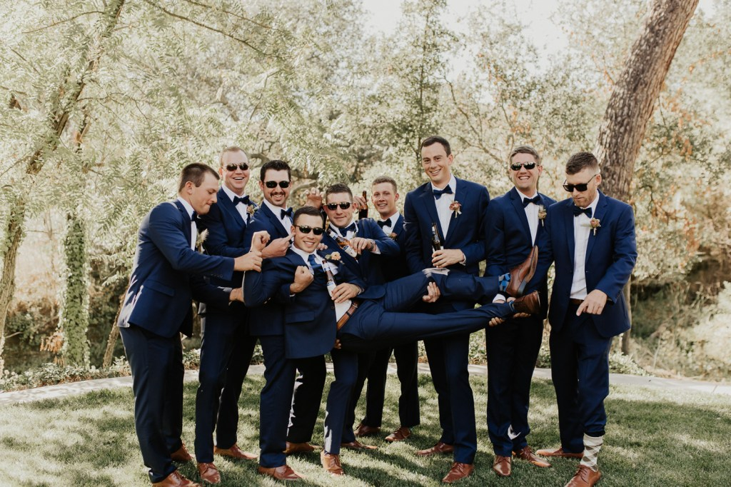 Megan Claire Photography | Northern California Wedding Photographer. Groomsmen in navy suits and crazy socks @meganclairephoto