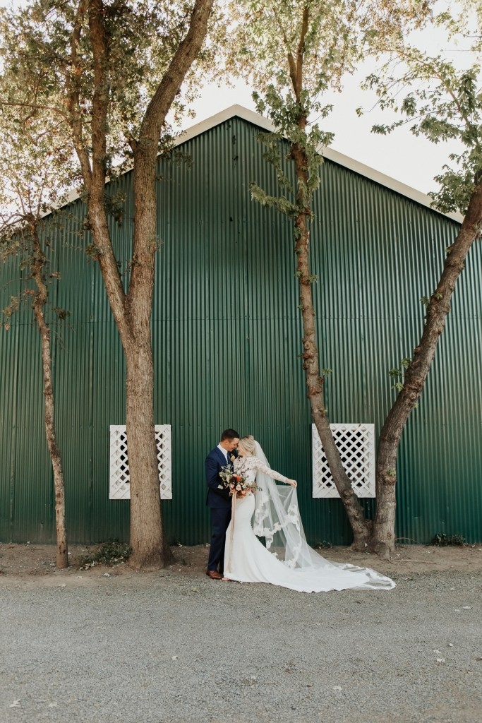 Megan Claire Photography | Northern California Wedding Photographer. Outdoor fall farm wedding bride and groom portraits in front of rustic green barn @meganclairephoto