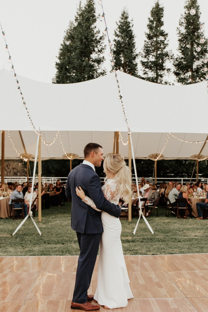 Megan Claire Photography | Northern California Wedding Photographer. Outdoor fall wedding reception with string lights, wood dance floor, and white tent @meganclairephoto