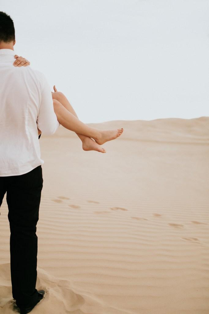 Megan Claire Photography | Phoenix Arizona Portrait, Couples and Wedding Photographer. Adventurous windy sand dunes engagement photoshoot @meganclairephoto