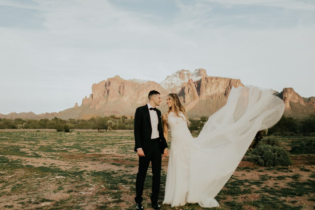 Megan Claire Photography | Arizona Wedding Photographer. Beautiful winter wedding in the desert at the Paseo in Apache Junction, Arizona near superstition mountains. Bride and groom wedding portraits in the desert