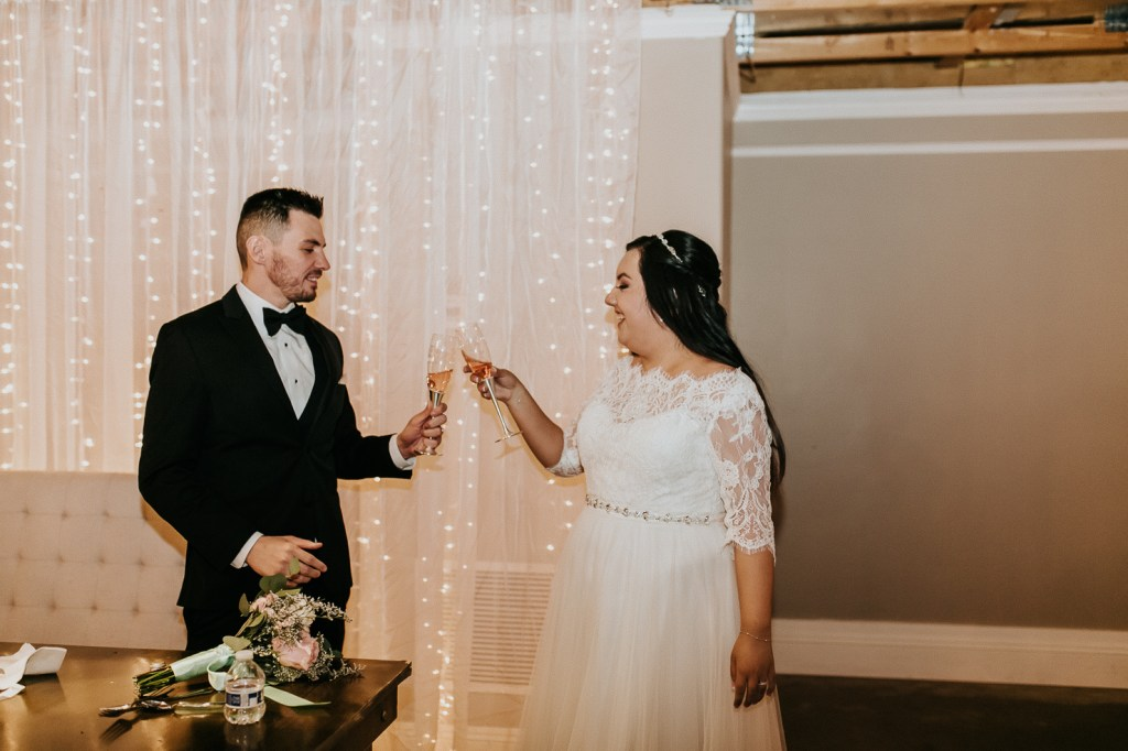 Megan Claire Photography | Arizona Wedding Photographer. Beautiful church wedding. Bride  and Groom wedding reception at elegant barn in Gilbert, Arizona bride and groom cutting cake photos