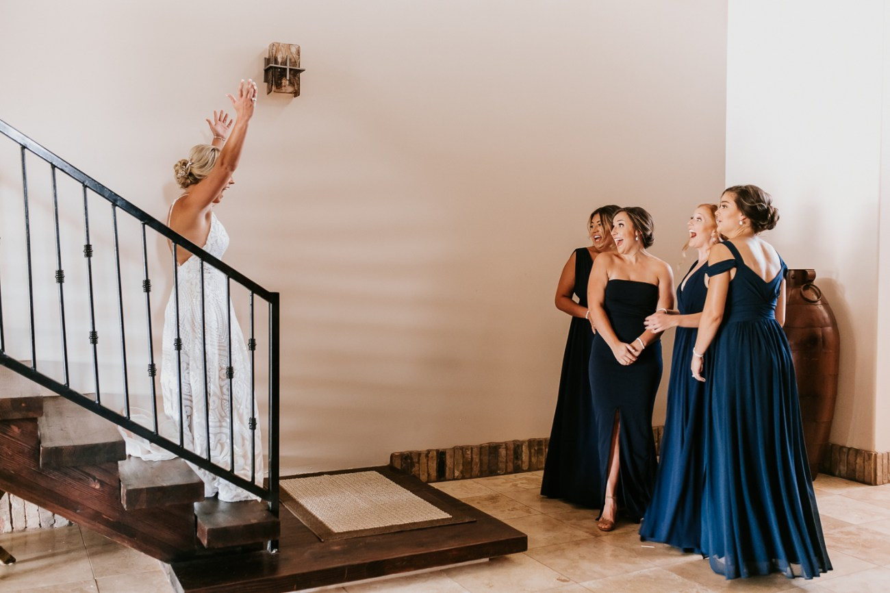 Megan Claire Photography | Arizona Wedding Photographer. Beautiful fall wedding in the desert at the Paseo in Apache Junction, Arizona near superstition mountains. Bride first look with bridesmaids @meganclairephoto