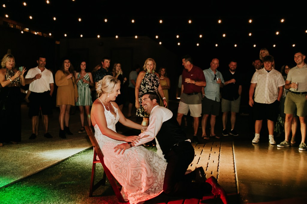 Megan Claire Photography | Arizona Wedding Photographer. Beautiful fall wedding in the desert at the Paseo in Apache Junction, Arizona near superstition mountains. Bride icing groom before garter toss @meganclairephoto