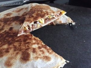 Easy Re-Fried Bean Quesadillas With one slice taken from the pie