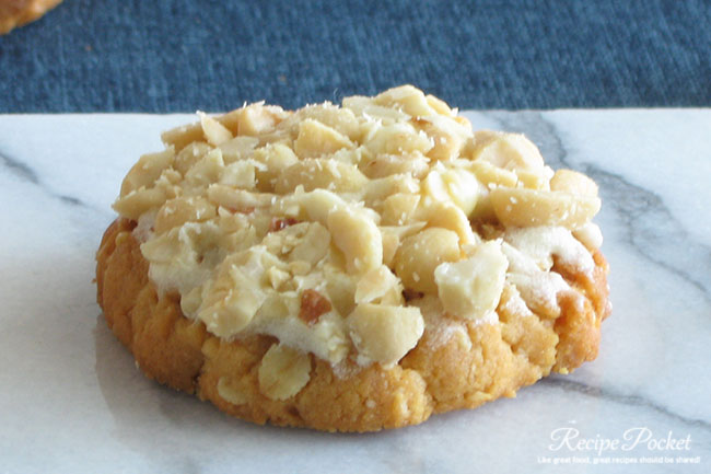 Peanut butter cookies topped with sdalted peanuts