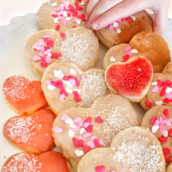 Image shows a large heart shaped sugar cookie with chocolate drizzled on top