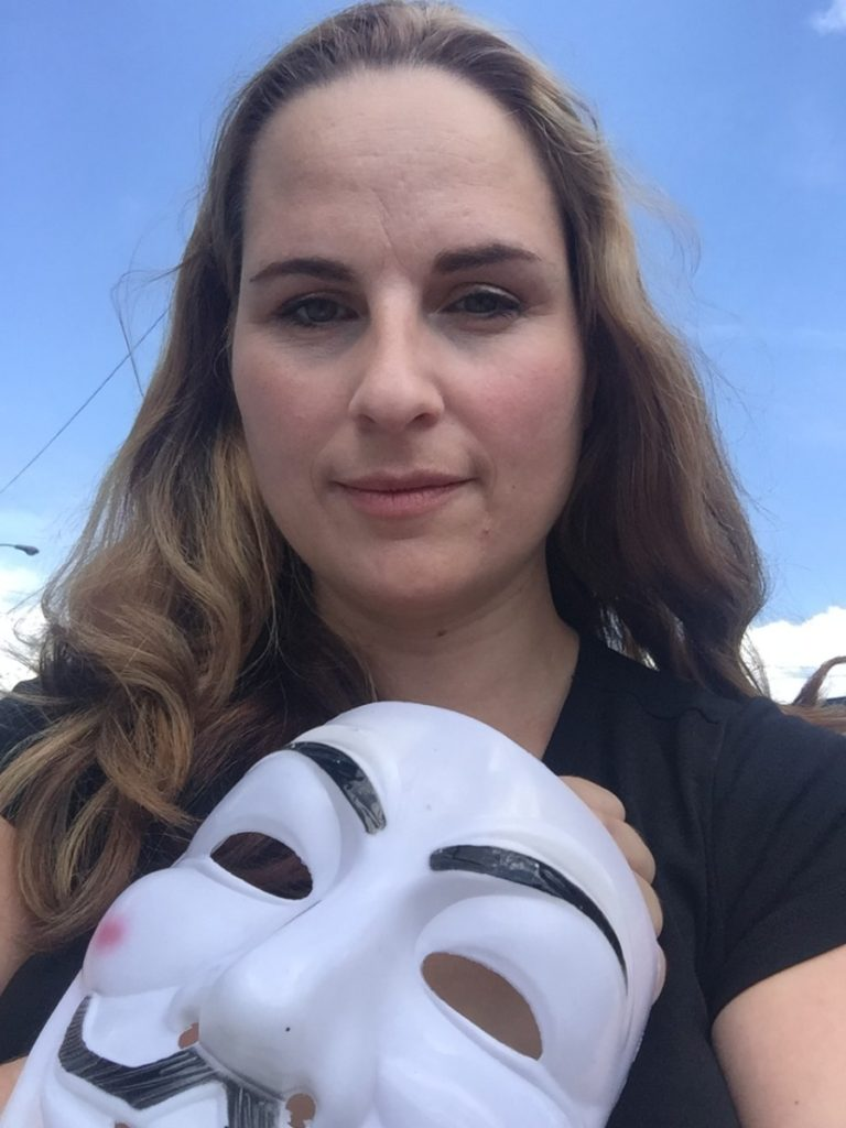 Megan holding a guy fawkes mask