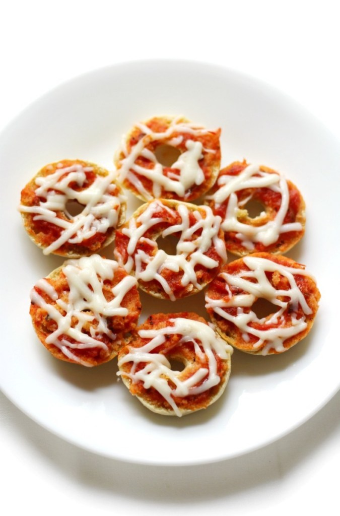 Vegan pizza bites stacked on a white plate