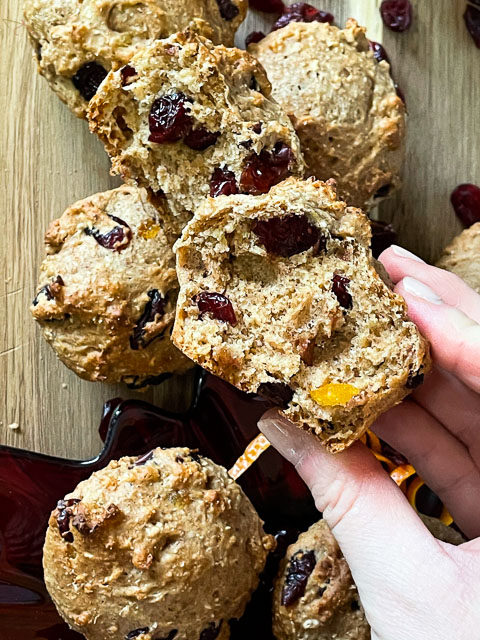 Cranberry orange muffin being held to the camera