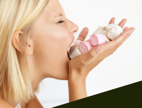 A woman stuffs marchmellows into her mouth. The test reads Toxic Hunger and how it hijacks your control